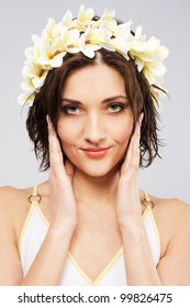 Portrait of a young beautiful woman in flower crown