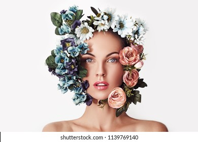 Portrait of a young beautiful woman  flowers on her head. Spring fashion photo. Skin care concept, beauty spa, bio product.