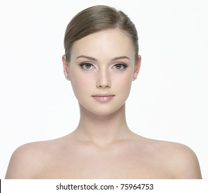 Portrait of young beautiful woman with fresh clean skin - isolated on white background