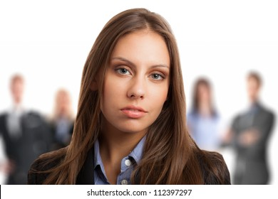 Portrait of a young beautiful woman in front of a group of people