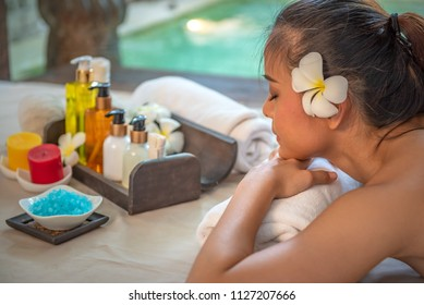 Portrait of young beautiful woman getting massage in spa environment, Traditional oriental aroma therapy and beauty treatments.