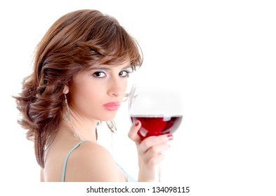 Portrait of young beautiful woman with glass of red wine