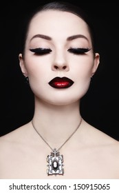 Portrait of young beautiful woman with gothic ombre lips and necklace