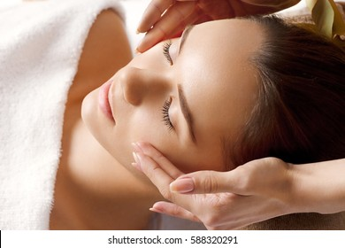 Portrait of young Beautiful woman having relaxing in spa massage salon. Leisure. Spa. Massage procedure. Healthy lifestyle and relaxation concept