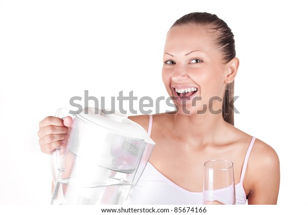 portrait of a young and beautiful woman with jug and glass