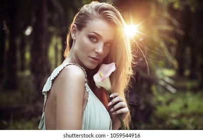 Portrait of young beautiful woman in the jungle