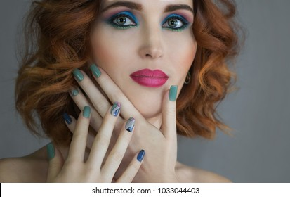 Portrait of young beautiful woman with makeup and beautiful nails touching her face. Nail Art Manicure.