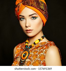 Portrait young beautiful woman with necklace. Fashion photo