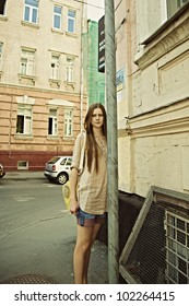 Portrait of a young beautiful woman on the street of the old city