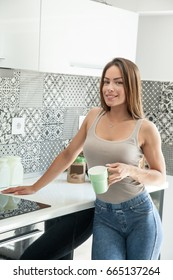 Portrait of young beautiful woman on kitchen