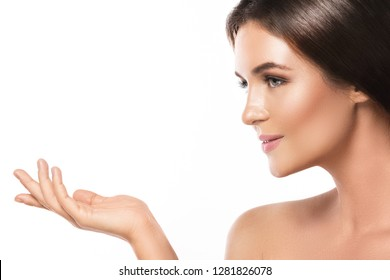Portrait of young and beautiful woman with a perfect smooth skin on white background
