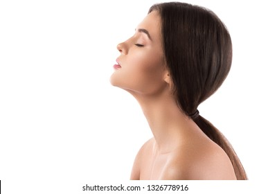 Portrait of young beautiful woman with perfect skin on white background