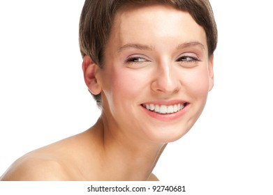 Portrait of young beautiful woman with perfect healthy skin and clear makeup smiling
