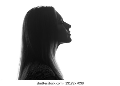 Portrait of a young beautiful woman in profile.