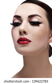 Portrait of young beautiful woman with red lips and cat eyes make-up over white background