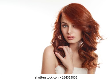 Portrait of a young, beautiful woman with red hair
