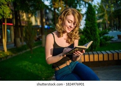 Portrait of young beautiful woman relaxing on the bench