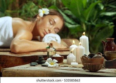portrait of young beautiful woman  relaxing in spa environment.