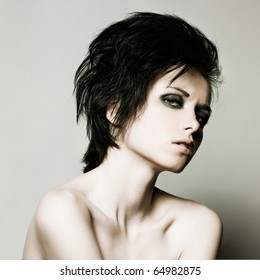 Portrait of young beautiful woman with short dark hair