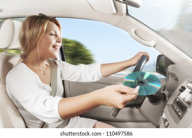 portrait of young beautiful woman sitting in the car