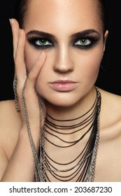 Portrait of young beautiful woman with smoky eyes and extended eyelashes