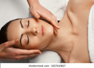 Portrait of Young Beautiful Woman in Spa Salon.Spa Body Massage Treatment and Skincare.Leisure. Face Massage.Facial treatment . Cosmetology