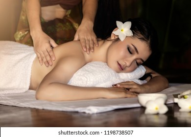 portrait of young beautiful woman in spa environment is being massage