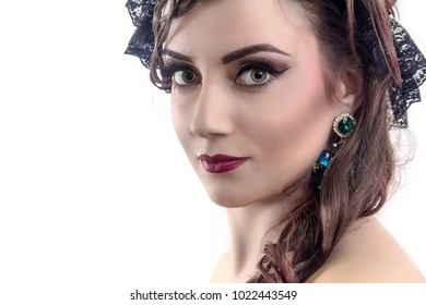 Portrait of young beautiful woman with stylish make-up and hair