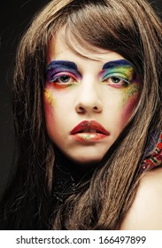 portrait of young beautiful woman with stylish bright make up