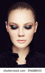 Portrait of young beautiful woman with stylish sexy smoky eyes make-up