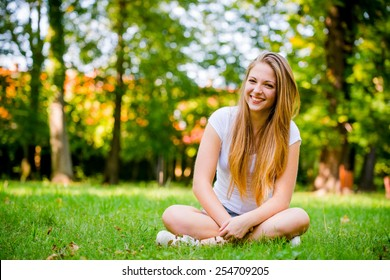 Portrait of young beautiful woman (teenage girl) - outside on grass