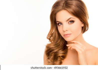 Portrait of young  beautiful woman touching her face