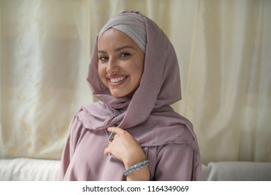 portrait of young beautiful woman wearing hijab