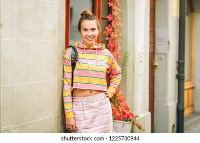 Portrait of young beautiful woman wearing stripe sweatshirt