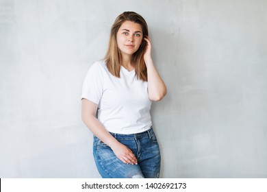 Portrait of young beautiful woman in white t-shirt and jeans