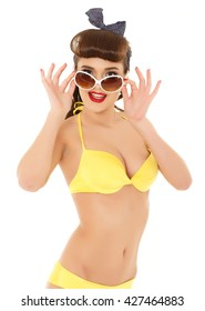 fbc7b904be3d0 Portrait of young beautiful woman in yellow bikini with sunglasses on a  white background. Vacation