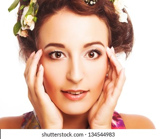 Portrait of young beauty with flowers in her hair.