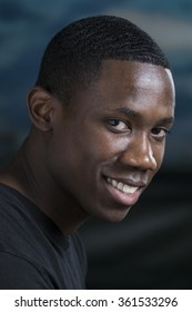 Portrait of a young black man, smiling