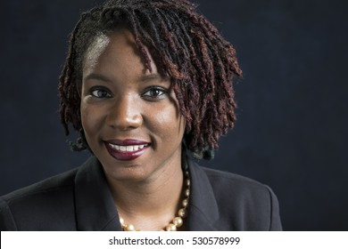 Portrait of a young black woman in a business suit