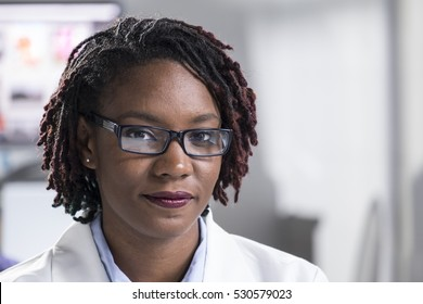 Portrait of a young black woman in a lab coat