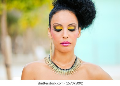 Portrait of a young black woman, model of fashion, with fantasy make up made by a professional beautician