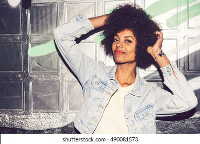 Portrait of a young black woman, model of fashion in urban background