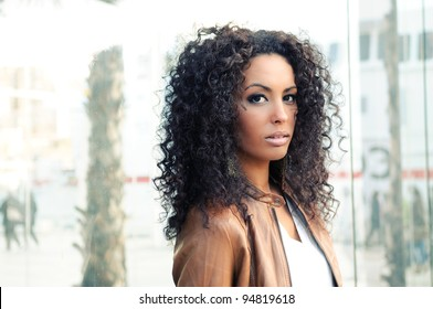 Portrait of a young black woman, model of fashion