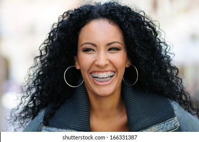 Portrait of a young black woman smiling with braces