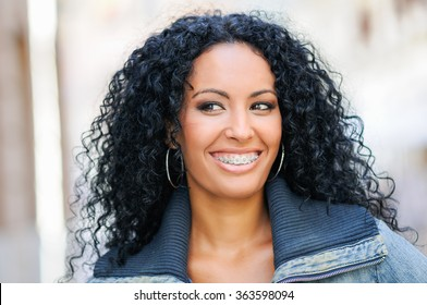 Portrait of young black woman smiling with braces