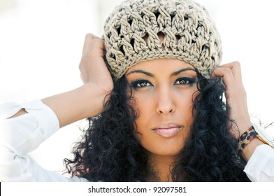 Portrait of a young black woman wearing a wool cap