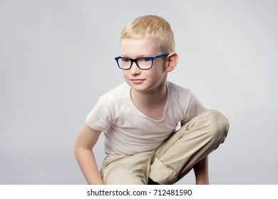 Portrait of young blond boy in glasses