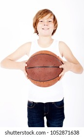 portrait of young blond boy holding a basketball