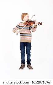 portrait of young blond boy playing the violin