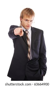 portrait of young blond man in black suit pointing his finger at the camera